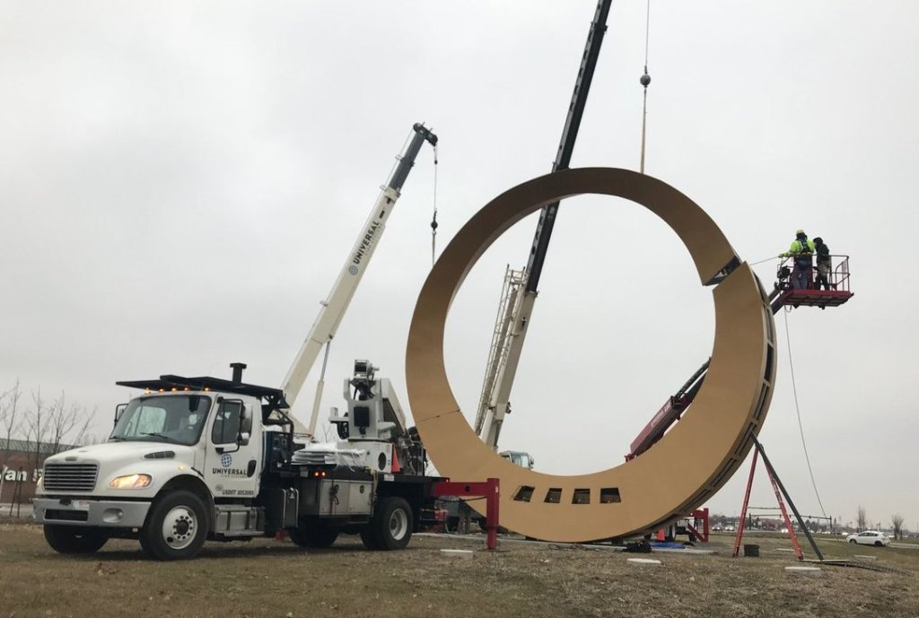 """The city of Sterling Heights, Mich., erected a large gold ring and new signage to promote M-59 as the """"Golden Corridor."""""""