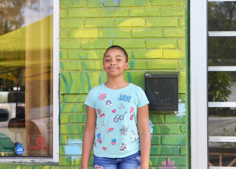 Morgan Watson, 11, stands in the Brightmoor Artisans Collective lot, where she now sells the produce she grows,August 9, 2019. Credit: Damon Mitchell.