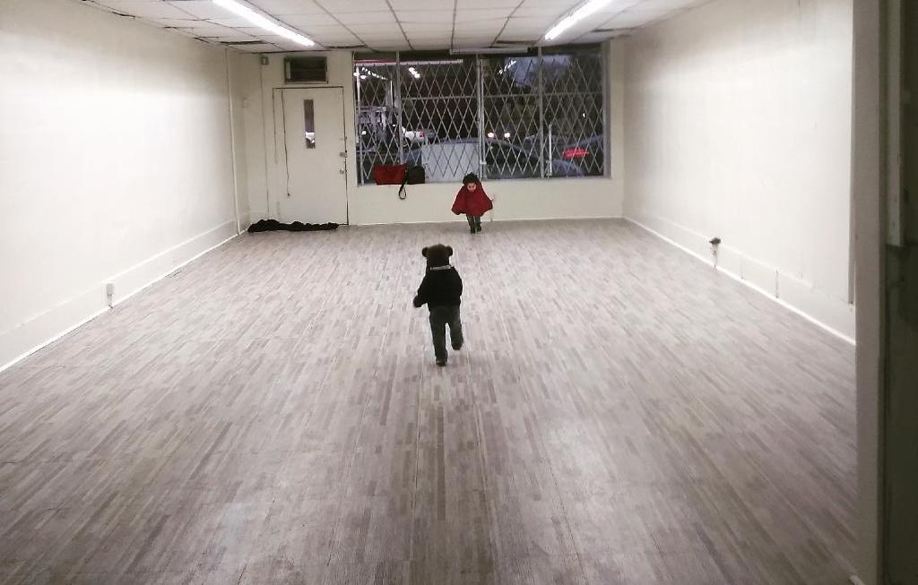Kristine Ferguson's two young sons play in her empty shop before it opened.