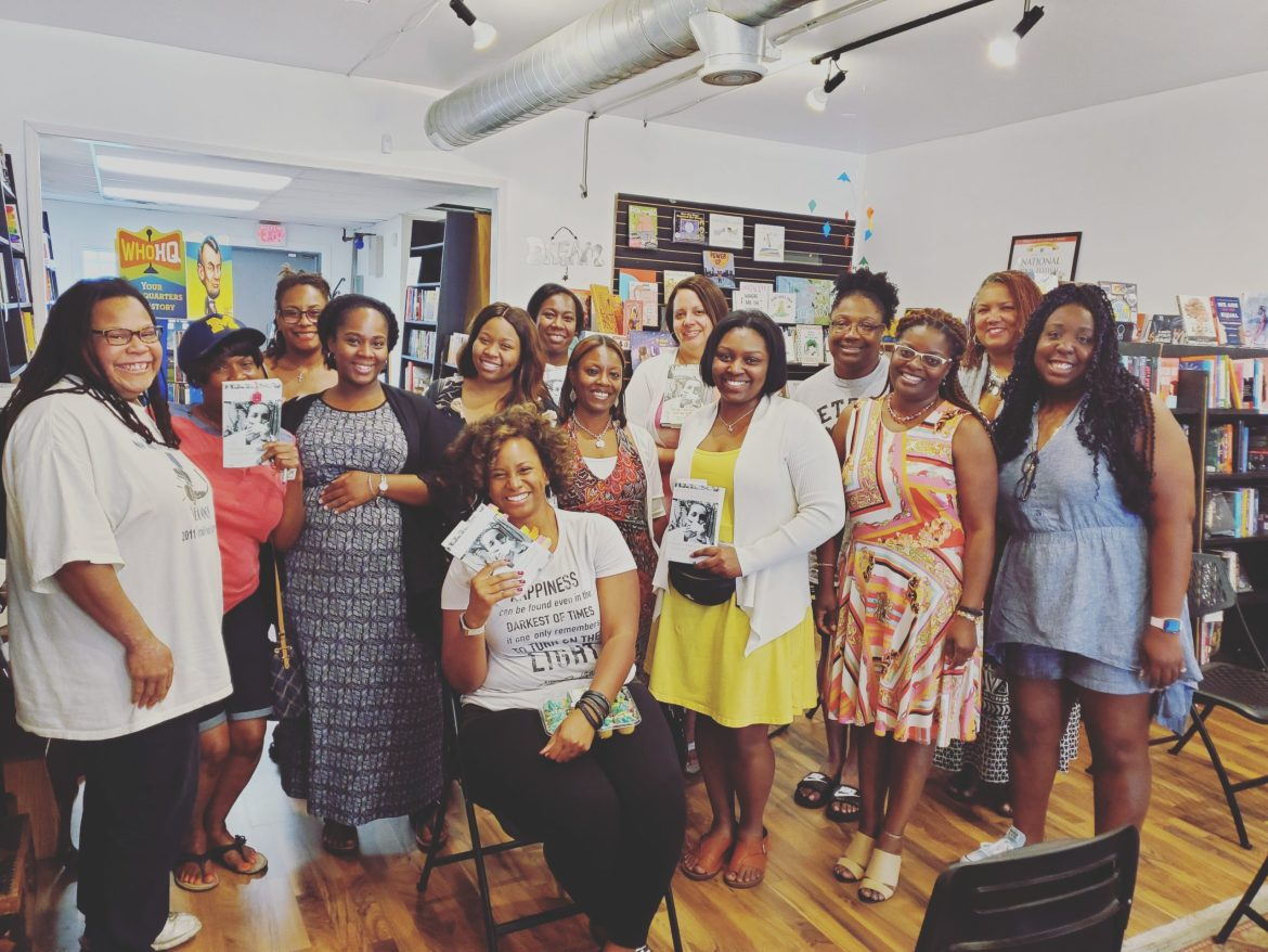 Dawn Sarai Robinson and other readers in the Well-Read Black Girl book club at Pages Bookshop in Detroit.