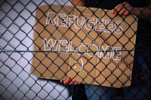 sign reading Refugees Welcome.