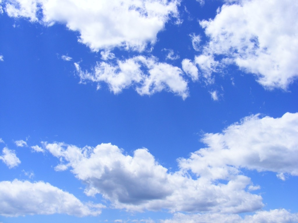 white clouds in bright blue sky