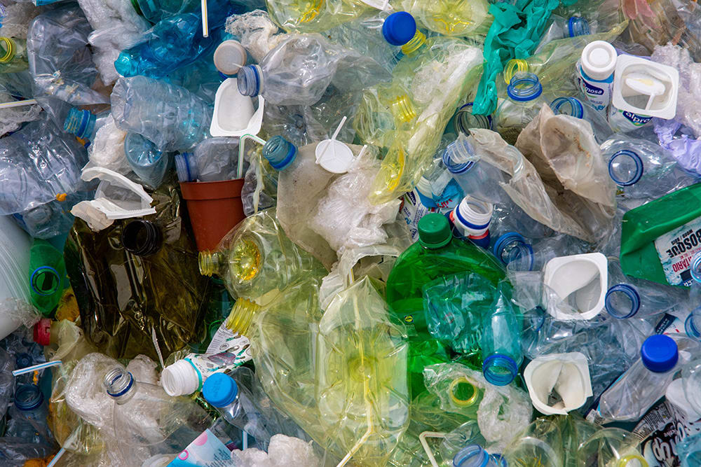 water bottles/plastics in large pile to be recycled