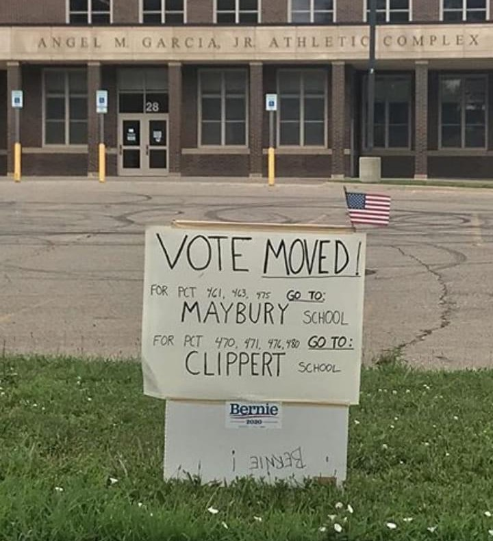 Handwritten sign indicating new location for a Detroit polling place during Michigan's primary election on Aug. 4.