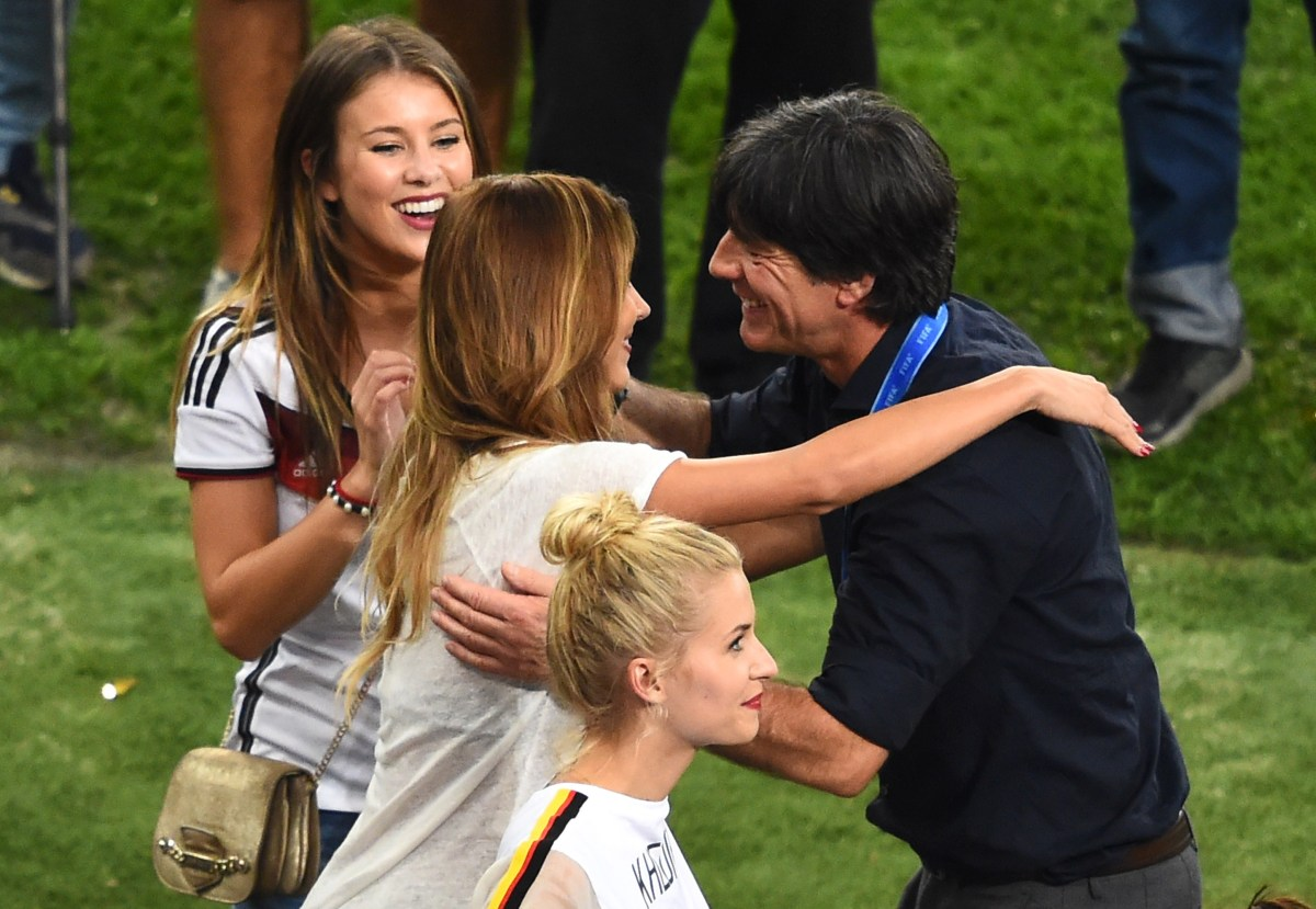 Coach Joachim Loew hugs a partner of a German squad member (AFP / Christophe Simon)