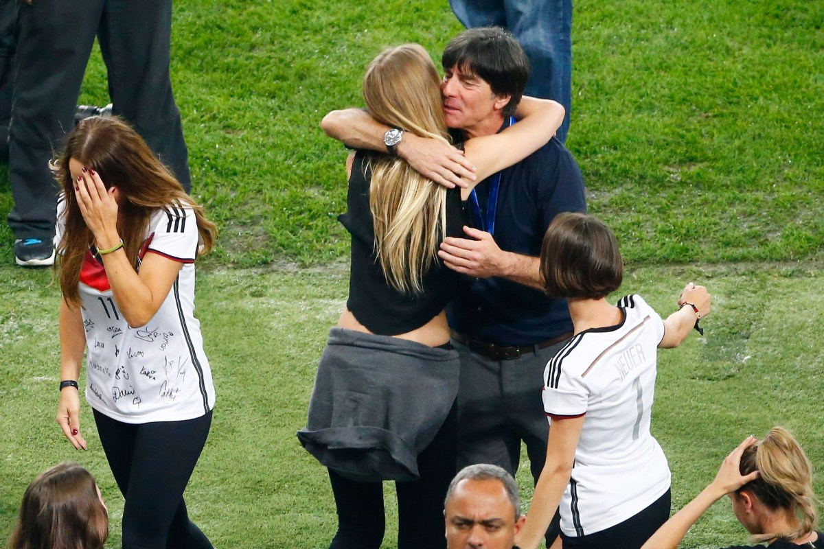 Joachim Loew hugs Sarah Brandner, girlfriend of Bastian Schweinsteiger (Photo by Jamie Squire/Getty Images)