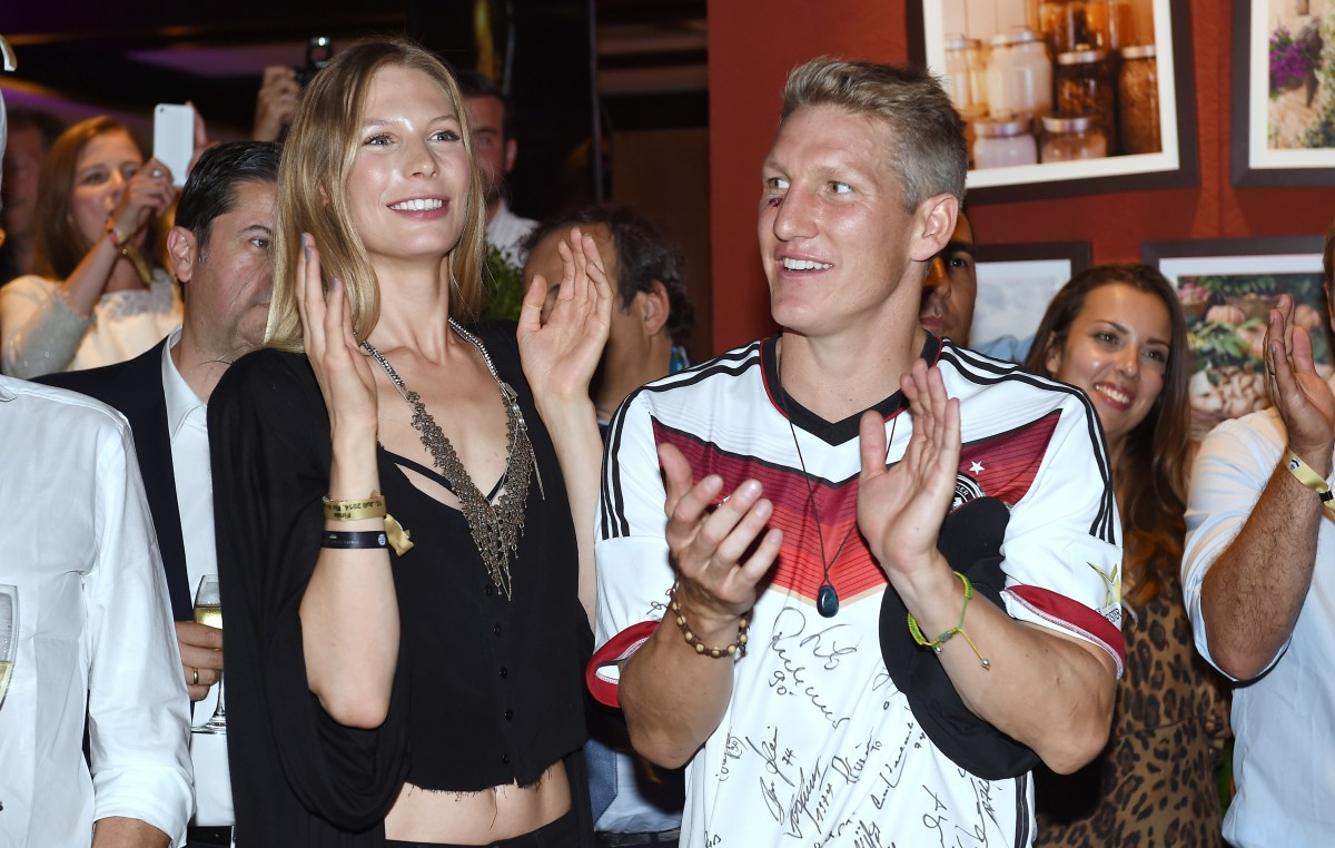 Bastian Schweinsteiger of Germany and girlfriend Sarah Brandner (Photo by Markus Gilliar - Pool/Getty Images)