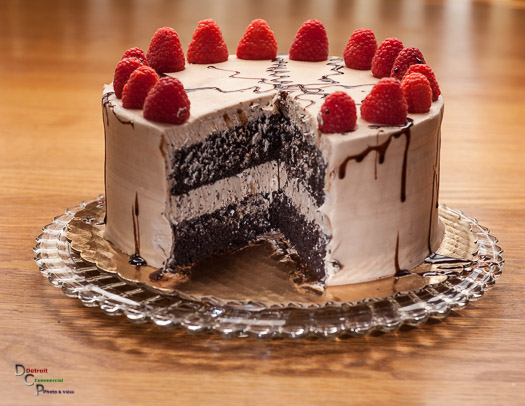 Chocolate Cake w/chocolate drizzle and raspberry's