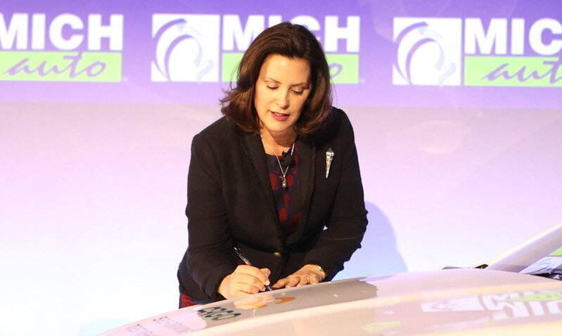 Michigan Governor Gretchen Whitmer signs executive orders at 2020 MICHauto Summit