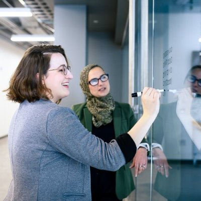 Katelyn Coberley and Bia Hamed work at Eastern Michigan University's Sill Hall.