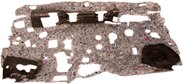 An Auria dash insulator, which absorbs engine noise coming through the firewall.