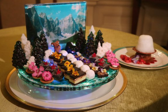 WASHINGTON, DC - MARCH 09: A display of bite-size sweets uses a photograph of the Rocky Mountains as a backdrop for the state dinner honoring Canadian Prime Minister Justin Trudeau in the State Dining Room at the White House March 9, 2016 in Washington, DC. The White House chose the colors, flowers and menu with 'an ambiance that reflects the scenic beauty of our shared border and celebrates the coming of spring.' The son of former Prime Minister Pierre Trudeau and the leader of Canada's Liberal Party, Trudeau is visiting Washington this week for the first state dinner for a Canadian leader in almost 20 years. (Photo by Chip Somodevilla/Getty Images)