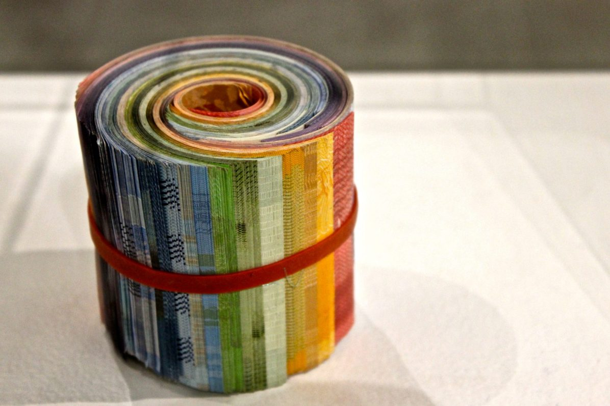 """A work by Columbian artist Adriana Martínez, """"At the End of the Rainbow"""" (2015), created through the accumulation of various South American currencies."""