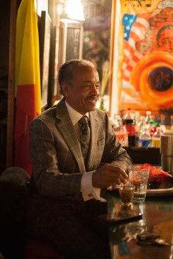 Larry Mongo sits at the bar, telling patrons about his love of music and Detroit. Photo by Stephanie Hume.