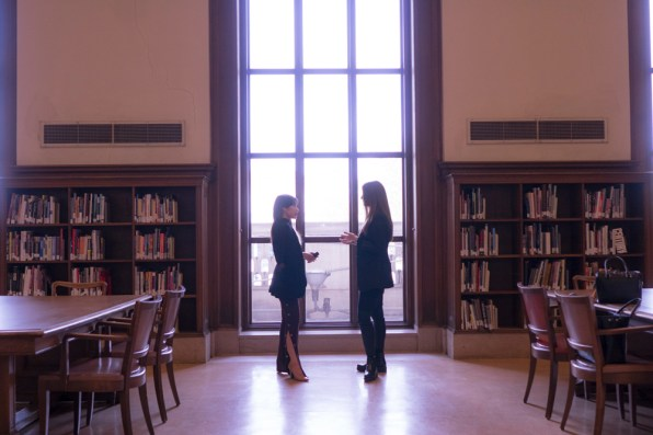 Moments at the window. Nancy Nguyen and Shelley Van Ripper talk fashion at the Detroit Public Library. Photo Katai