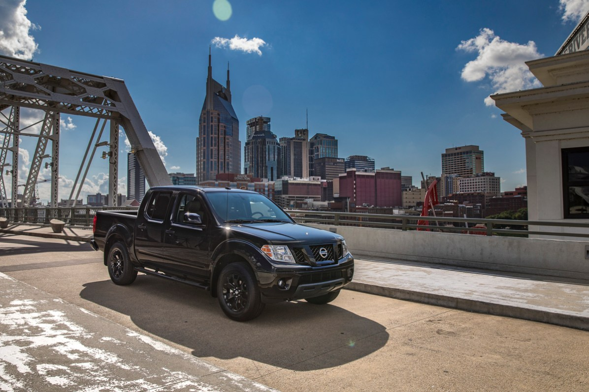 The new Frontier Midnight Edition adds a gloss-black grille, semi-gloss black step rails, body-color front and rear bumpers, black outside rearview mirrors and door handles, and black Midnight Edition badging.