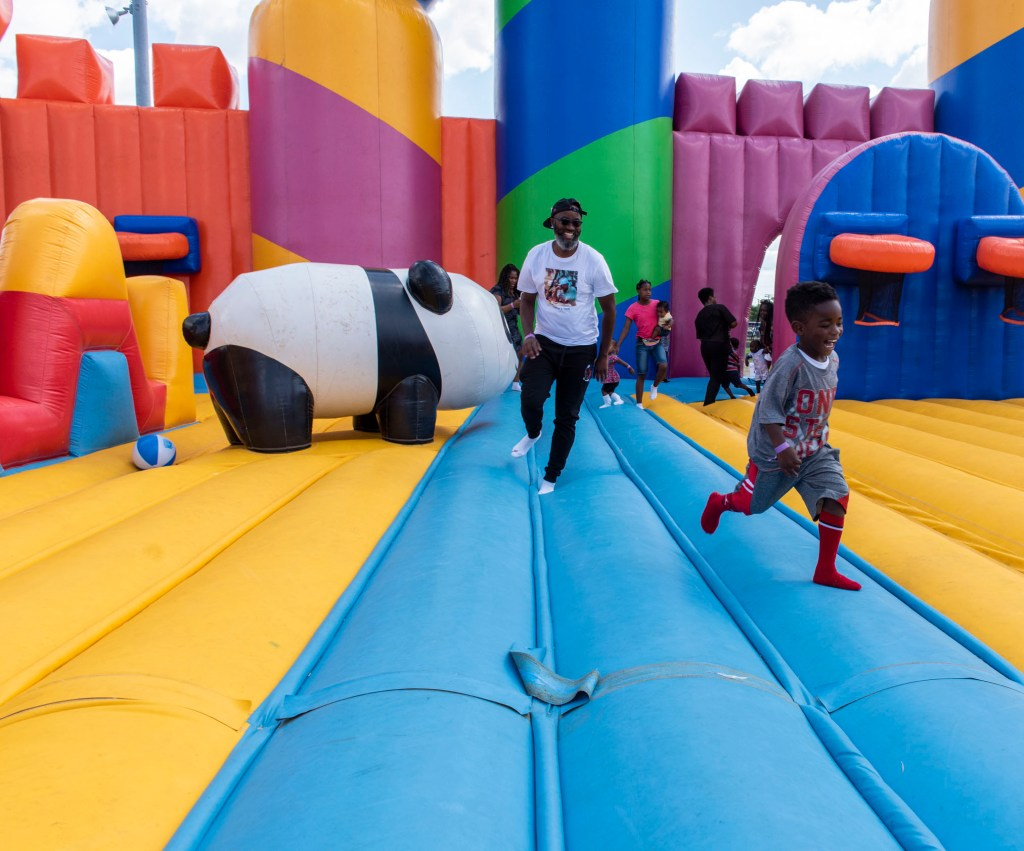 Children and volunteers play inside of the worlds largest bounce house on the last day of the Six Day Project.