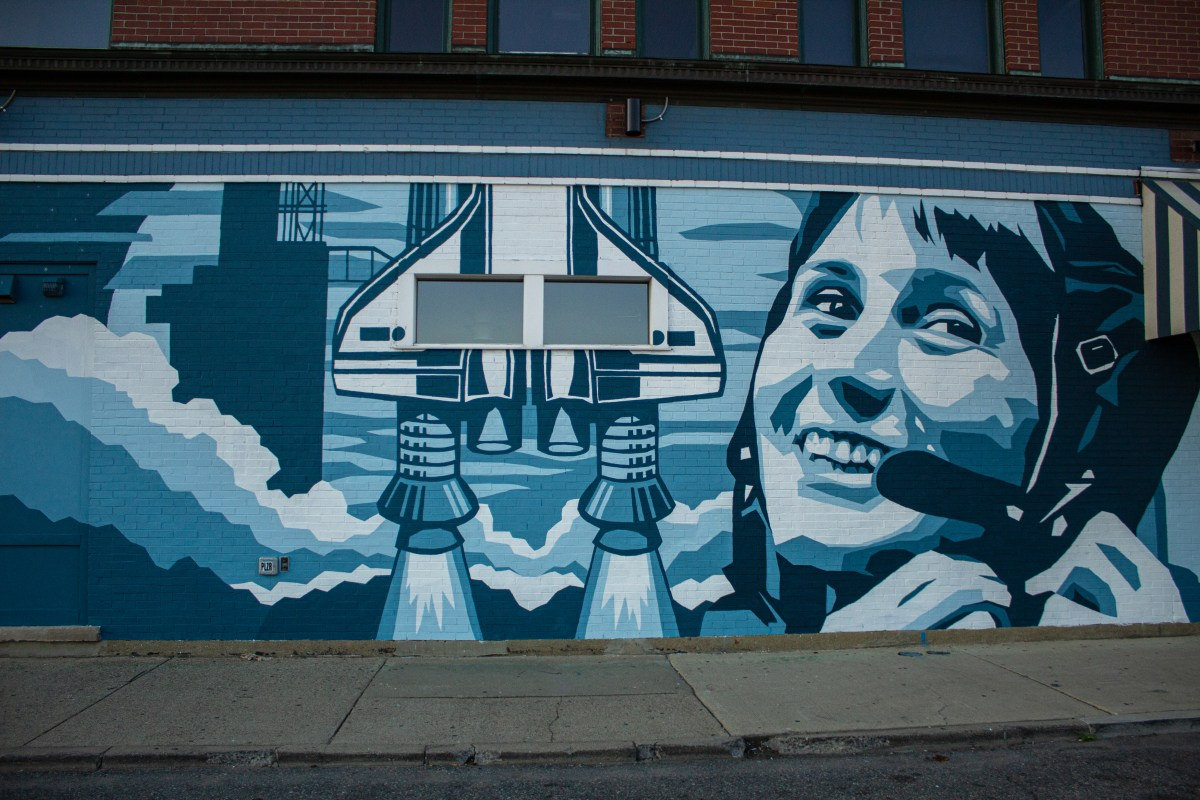 THE MURAL OF FEMALE ASTRONAUT CRISTOFORETTBY ORTICANOODLES OUTSIDE OF SUPINO PIZZA IN EASTERN MARKET. PHOTO JOHN BOZICK