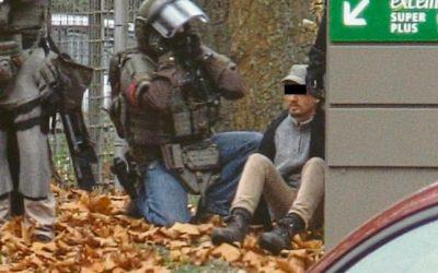شرطي يحتجز رهنية في محطة وقود ويهدد بتفجير قنبلة