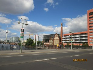 A group of buildings on the Spree. The Wahlplakate, or political campaign posters, are scattered around the city like weeds. Elections are on the 16th of September.