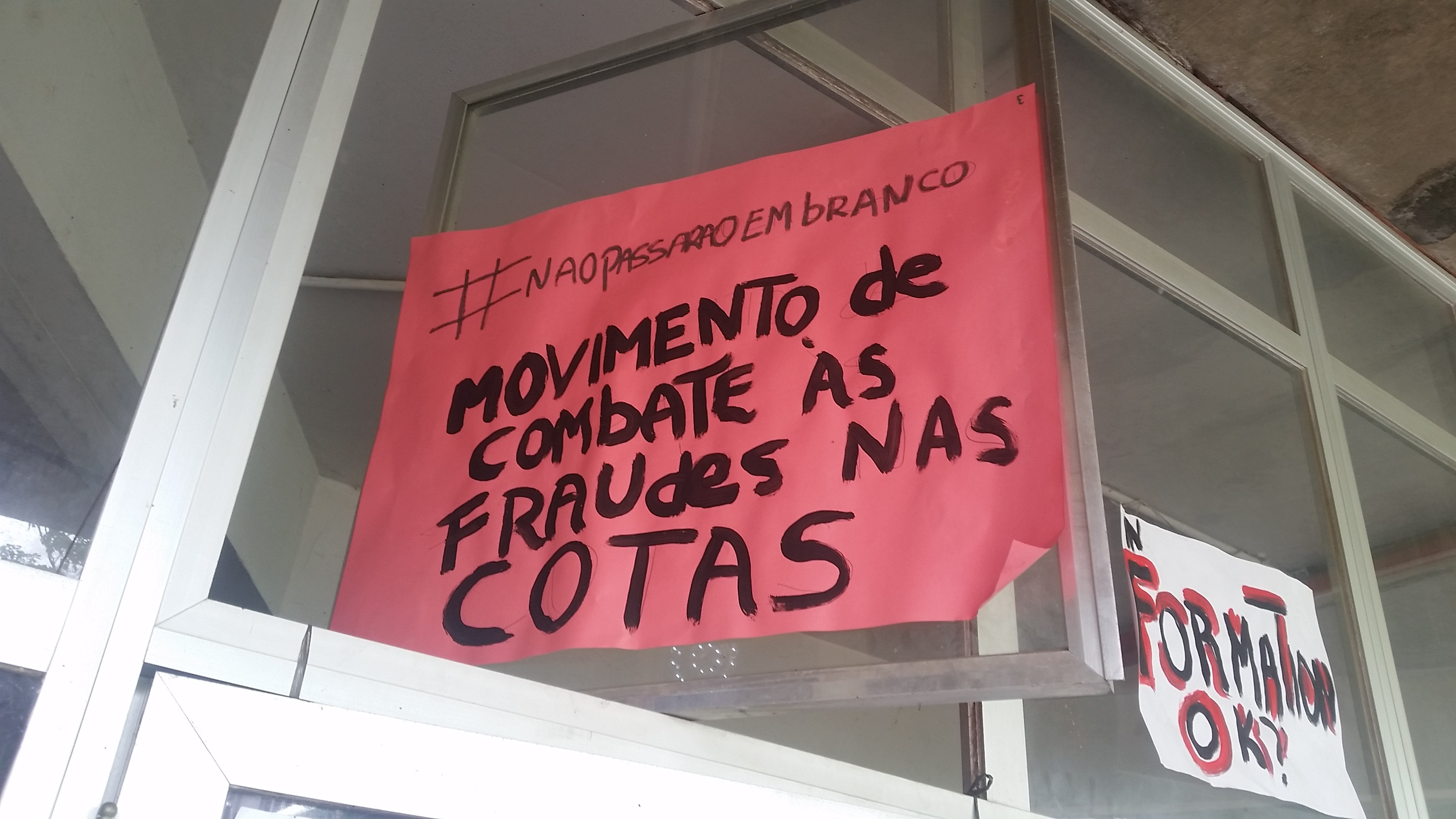 """A sign hung outside the QuIlombo reads """"Movement to combat fraud in the quotas"""" (Photo by Kristian Davis Bailey)"""