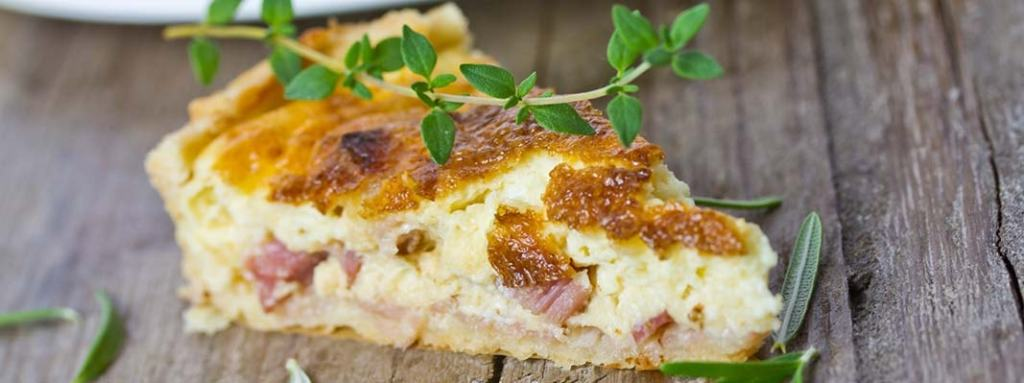 St. Supéry Quiche Lorraine close up on wooden table