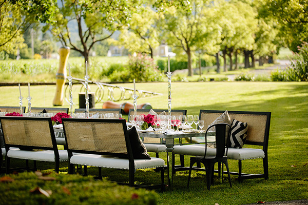 Chic tablescape under the oak tree among the vineyards at St. Supéry