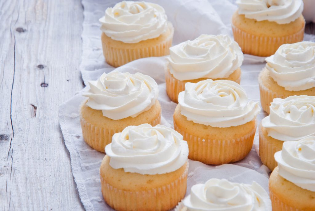 Golden St. Supéry Napa valley Estate Moscato cupcakes with swirls of vanilla frosting