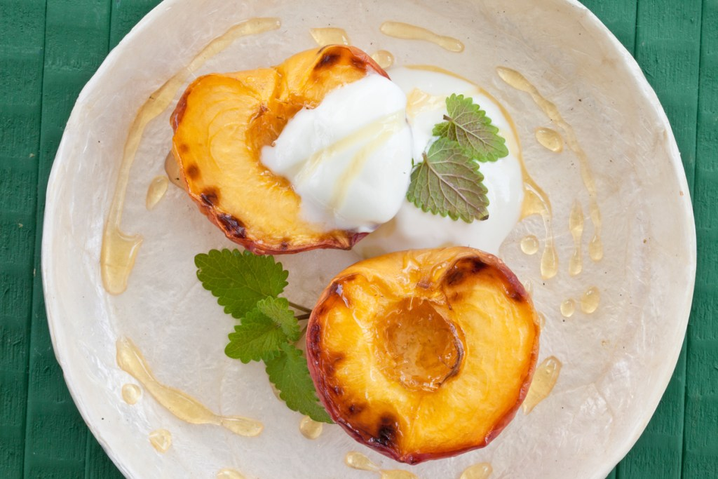 Grilled peach with honey, mint and yogurt