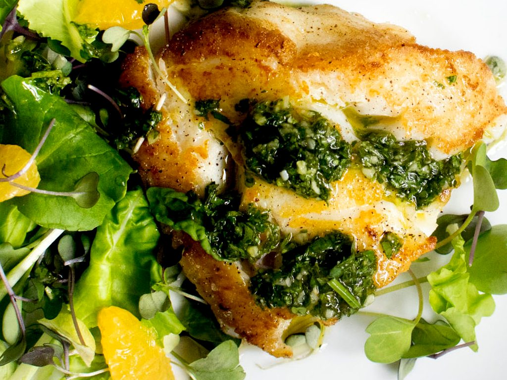 Pan Seared Cod with Citrus Chimichurri served with orange microgreen salad, a perfect pairing with St. Supéry Napa Valley Estate Sauvignon Blanc