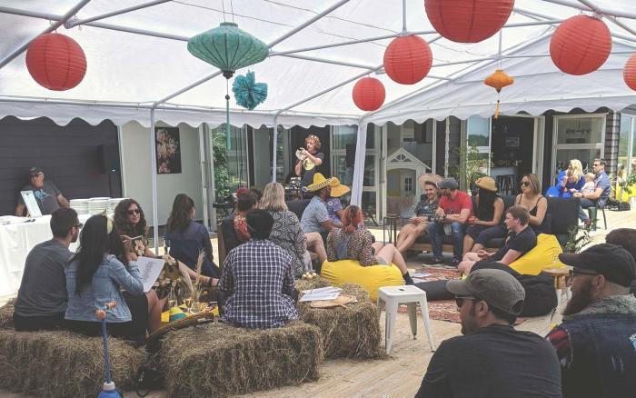 Optimal Workshop CEO speaking to team members at social event