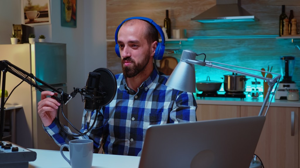 man speaking during his online show into professional microphone creative online show air production internet broadcast host streaming live content recording digital social media communication