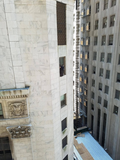 Window cleaner on multi storey tower