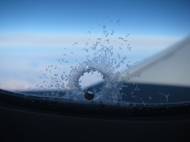 tiny holes on the windows of airplanes
