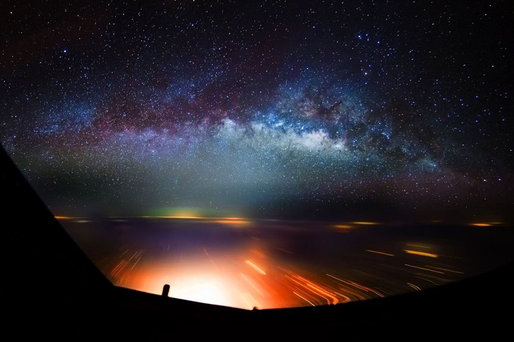 City lights beneath night sky