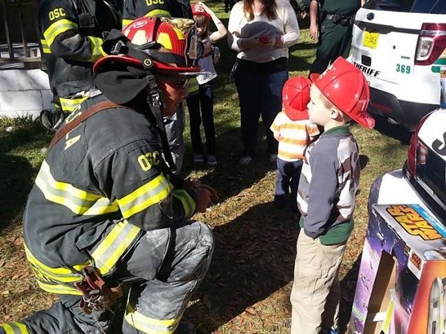 firefighter talking to kid