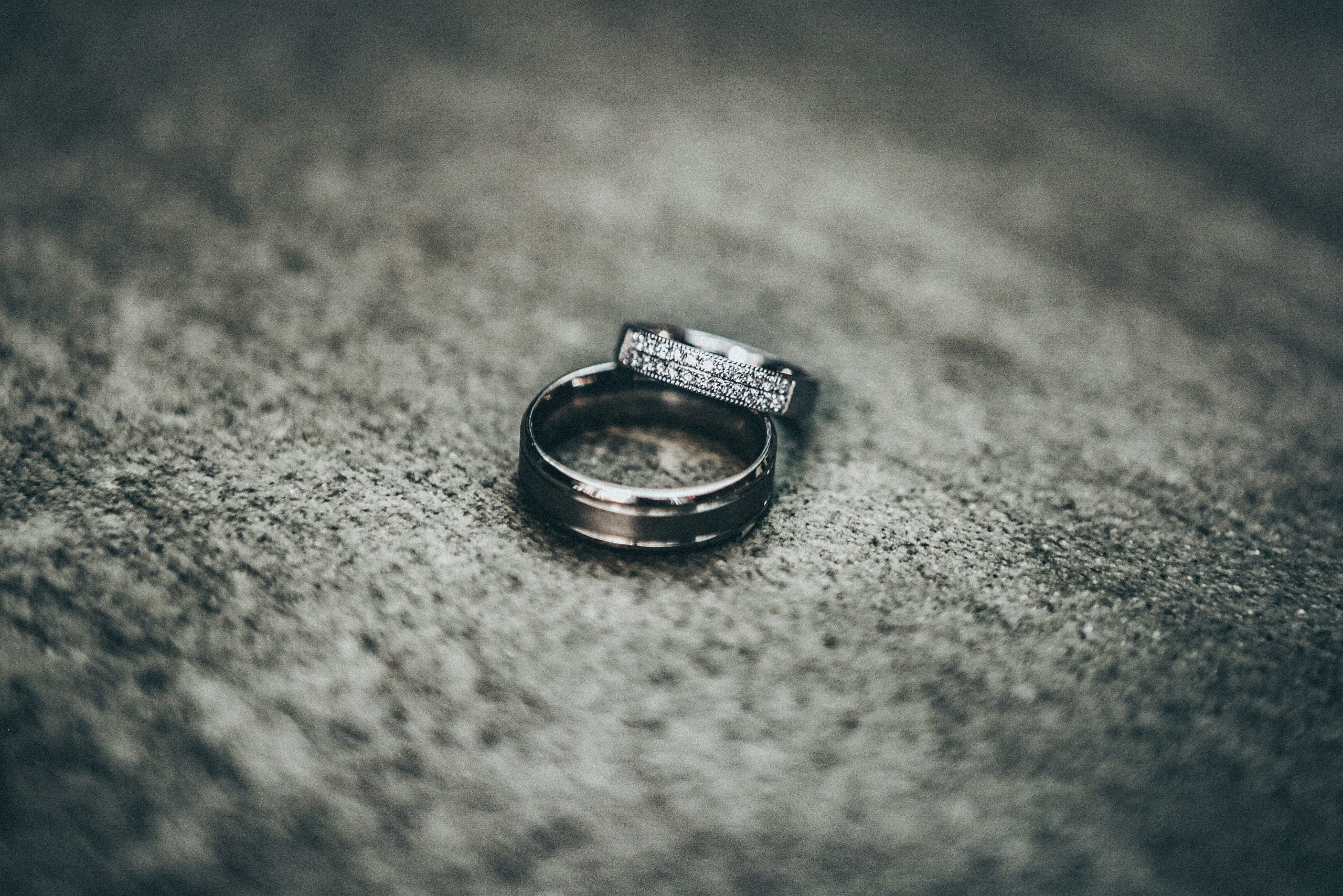 silver-colored rings on gray pavement