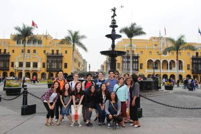 May participants stop for a photo in Historic Downtown Lima