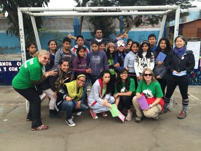 Peru D ESL teachers and Health Club volunteers join the students from Tupac Amaru II for a photo