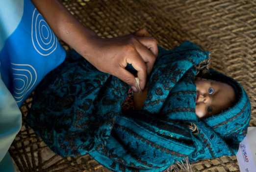 November 19, 2013 - Binauna village, Banke (Nepal). Syani Tharu is eight months pregnant. Here, Jharana Kumari Tharu - a female community health volunteer in her village – is visiting her at her home and counseling her on how a simple tube of chlorhexidine antiseptic gel, applied to her baby's cut umbilical cord stump could help prevent infection and even death. USAID and partner JSI are supporting the scale-up of the use of this life-saving intervention throughout the country.