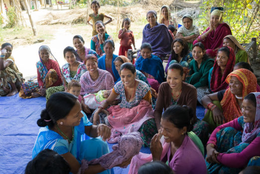 November 19, 2013 - Binauna village, Banke (Nepal). Female Community Health Worker Jharana Kumari Tharu councils a group of women, including expectant mothers and those who have recently delivered, on good health practices in Binauna village, in Nepal's Banke District. One of the many interventions that Jharana helps promote is how to apply a chlorahexidine-based antiseptic gel on a newborn's cut umbilical cord stump to prevent infection. This simple life-saving intervention, which is supported by USAID and partner JSI throughout Nepal, has been shown to reduce infant mortality by roughly one third in a large community trial conducted in Nepal by the Johns Hopkins University Bloomberg School of Public Health in conjunction with partner organization Nepal Netra Jyoti Sangh. © Thomas Cristofoletti / Ruom for USAID