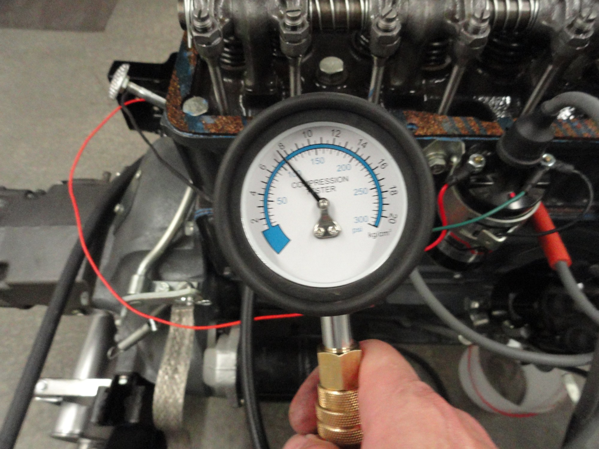 hight resolution of with the ignition switch off make sure its off remove all the spark plugs and the distributor cap prop the throttle wide open to get the most accurate