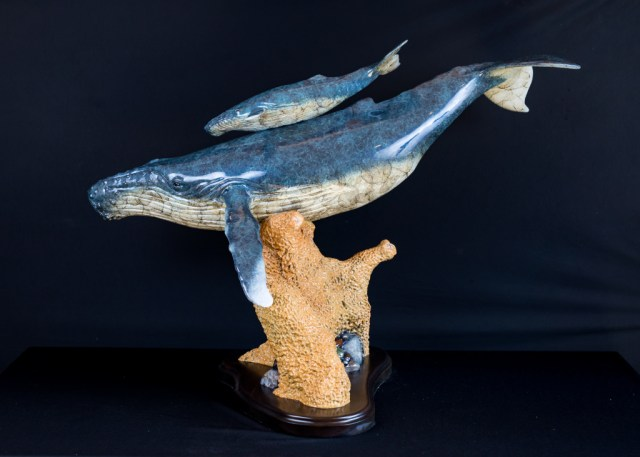 A whale and baby swimming in the bronze sculpture 'Guidance'.