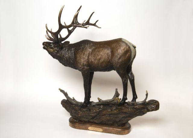 An elk sounds out a mating call in the bronze sculpture 'Broken Silence'.