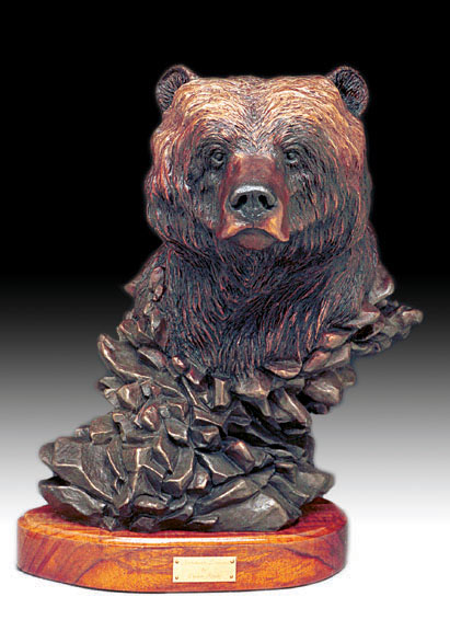 The bronze sculpture 'Northern Dreams' of a grizzy bear's head.
