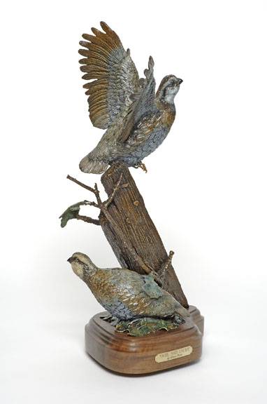 Two bob white quail in the bronze 'Over and Under: Quail' by Devin Rowe.