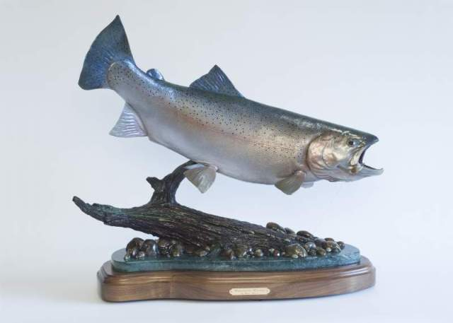 The bronze sculpture 'Whispering Waters' features a steelhead trout.