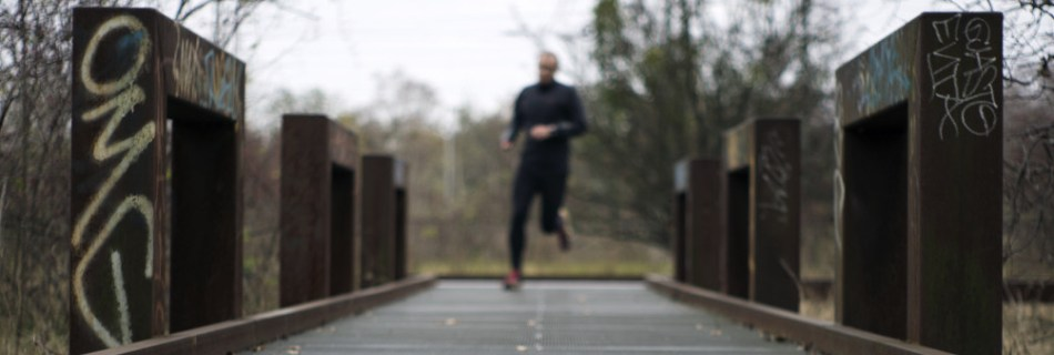 "runner in park ""Natur-Park Schöneberger Südgelände"" in the city of Berlin where nature and art are meeting in the industrial setup of a former marchalling yard. I was playing with focus and blur that day."