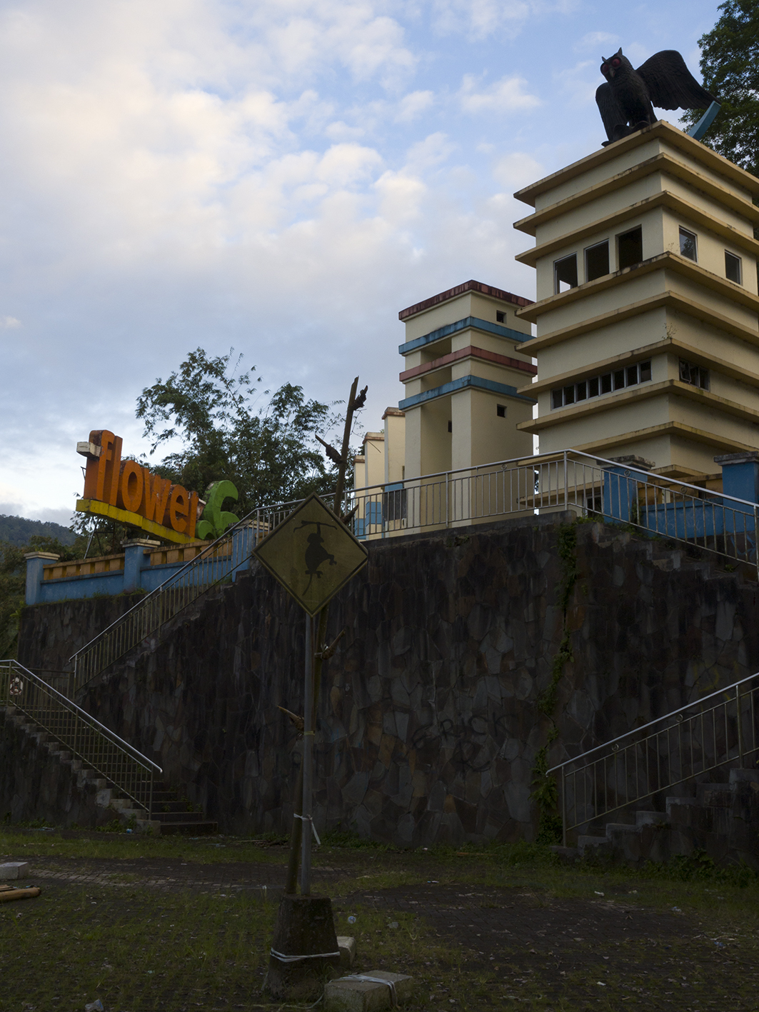 Signs and towers with owl at resting and view point: Tomohon (Sulawesi, Indonesia)