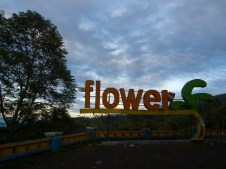 Sunset with sign FLOWER at resting area and view point at Tomohon (Sulawesi, Indonesia)